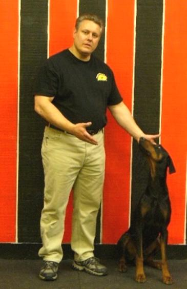 Rick Froton and Blue (aka Geronimo von Rubenhof) pose after CGC test