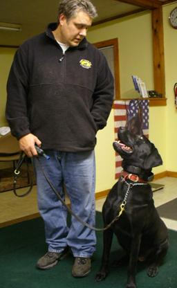 Rick Froton of Fortunate K9 with a boarding dog